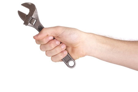 a hand holding a wrench isolated on white background photo