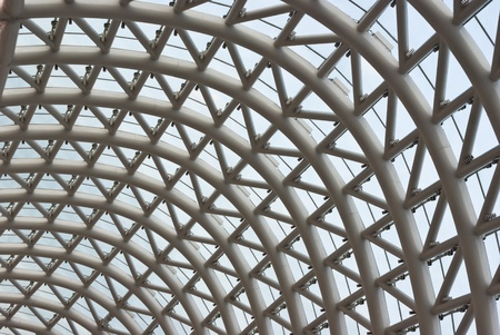 Glass roof with metal baffles photo
