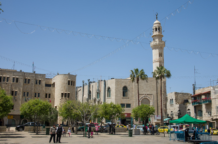 omar: BETHLEHEM, ISRAEL - APRIL 09, 2014:View of Manger Square and Mosque of Omar  Editorial