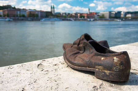 fascist: The Shoes on the Danube Bank monument in Budapest, Hungary, was built in memory of the jews who were killed by fascist Arrow Cross militiamen in Budapest during World War II Editorial