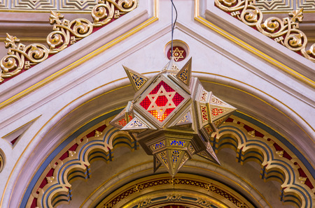 Star of David hanging over the altar of Dohany street Synagogue at Budapest, Hundary photo