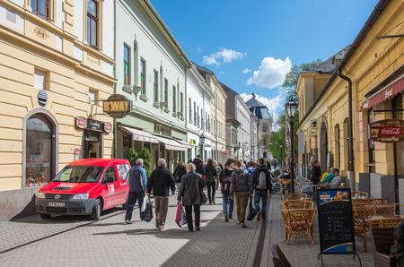 EGER  HUNGARY - APRIL 16: Unidentified poeple walking in a street in Eger on April 16, 2014 in EgerHungary