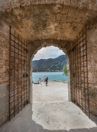 ancient prison: the gate of the leper colony of Spinalonga Island, Crete, Greece Editorial