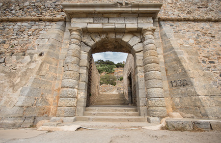 the gate of the leper colony of Spinalonga Island, Crete, Greece Editorial