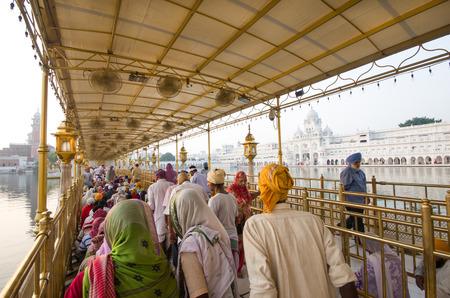 AMRITSAR, INDIA - SEPTEMBER 23: Sikh pilgrims in the Golden Temple on September 23, 2014 in Amritsar, Punjab, India. The Golden Temple is the holiest pilgrimage site for the Sikhs.