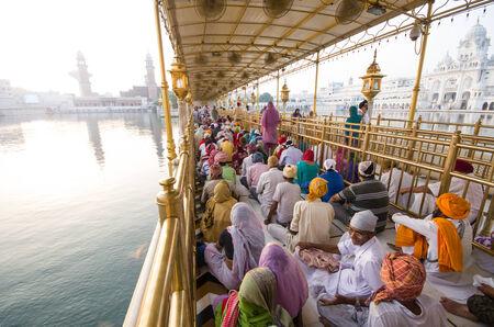 holiest: AMRITSAR, INDIA - SEPTEMBER 23: Sikh pilgrims in the Golden Temple on September 23, 2014 in Amritsar, Punjab, India. The Golden Temple is the holiest pilgrimage site for the Sikhs.