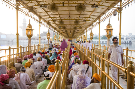 AMRITSAR, INDIA - SEPTEMBER 23: Sikh pilgrims in the Golden Temple on September 23, 2014 in Amritsar, Punjab, India. The Golden Temple is the holiest pilgrimage site for the Sikhs.