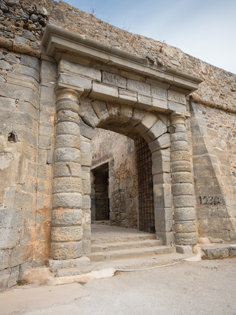 ancient prison: the gate of the leper colony of Spinalonga Island, Crete, Greece Stock Photo