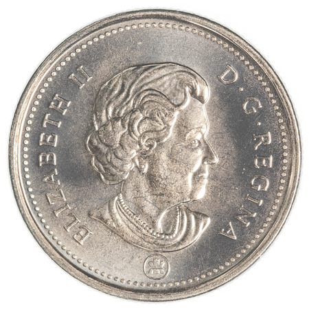 canadian cash: TORONTO, CANADA - FEBRUARY 20, 2015: 25 canadian cents coin