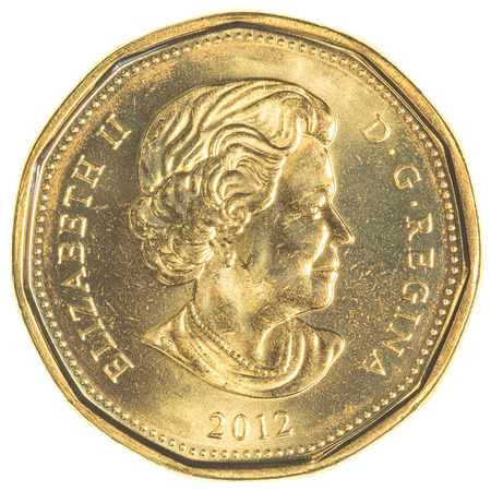 bimetallic: TORONTO, CANADA - FEBRUARY 20, 2015: Canadas two dollar coin is bimetallic, and shows a polar bear, a symbol of concern for the endangered environment. Editorial