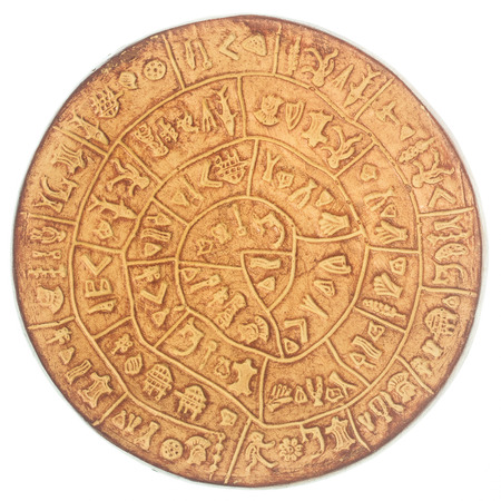 cryptogram: phaistos disc, an artefact discovered at the minoan site of Phaistos, Crete - Greece