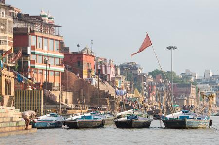 varanasi: VARANASI, INDIA - SEPTEMBER 3, 2014: Unidentified people on the banks of the Ganges river
