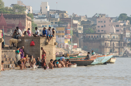 ganges: VARANASI, INDIA - SEPTEMBER 3, 2014: Unidentified people on the banks of the Ganges river