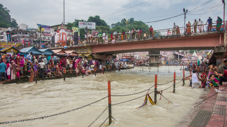 pooja: HARIDWAR, INDIA - AUG 29 2014: Devotees gathered to make a holy dip at river Ganges Editorial