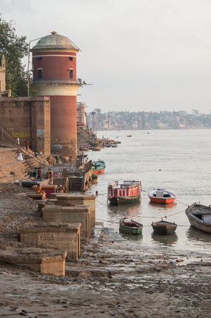 ghat: VARANASI, INDIA - SEPTEMBER 3, 2014: Unidentified people at Tulsi Ghat on the bank of the Ganges river