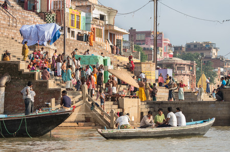 benares: VARANASI, INDIA - SEPTEMBER 3, 2014: Unidentified people on the banks of the Ganges river