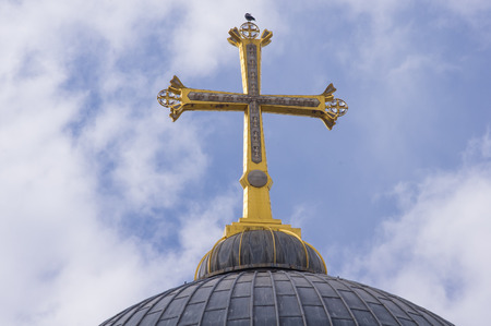 sepulchre: the golden cross on top of the Curch of the Holy Sepulchre at the old city of Jerusalem, Israel