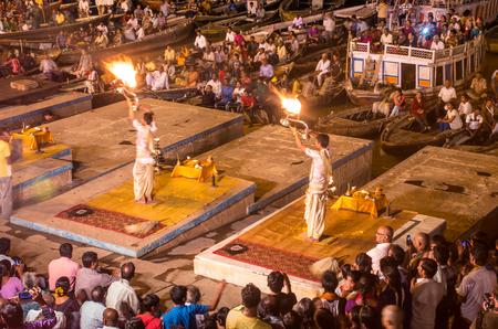 varanasi: VARANASI, INDIA - SEP 04 2014 - Brahmin priests perform a Puja ceremony to the sacred river Ganga