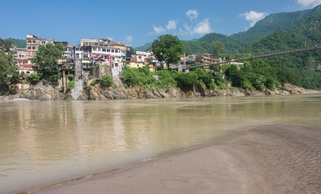 tera: view of the holy city of Rishikesh from the banks of the Ganges river, uttarakhand - India Stock Photo
