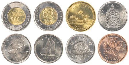 TORONTO, CANADA - APRIL 19, 2015: circulating Canadian Dollar coins Stock Photo