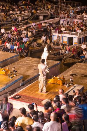 benares: VARANASI, INDIA - SEP 04 2014 - Brahmin priests perform a Puja ceremony to the sacred river Ganga