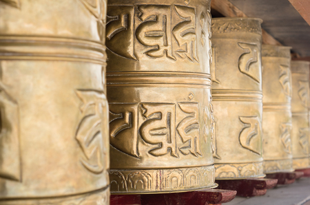 sanskrit: buddhist prayer wheels at Stakna monastery. Leh - Ladakh, India Stock Photo