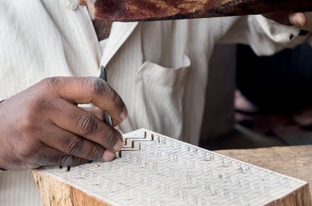 printing block block: a craftsman carving a wooden printing block for textile block printing at the village of Sanganer, Rajasthan - india Stock Photo