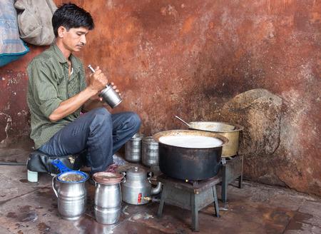 masala chai: JAIPUR, INDIA - SEPTEMBER 8, 2014: Street vendor preparing sweet masala chai Editorial