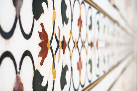 mughal: AGRA - INDIA. SEPTEMBER 07, 2014. Mughal stone art on the facade of the Taj Mahal