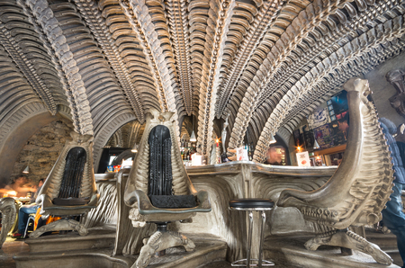 biomechanical: GRUYERES, SWITZERLAND - JANUARY 16, 2016: interior of HR Giger cafe in Gruyeres, themed along the lines of his biomechanical style as shown in the Alien films Editorial