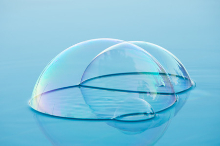 surface tension: single soap bubble on water surface