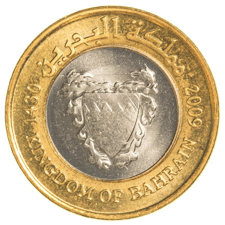 bahrain money: 100 Bahraini dinar coin isolated on white background