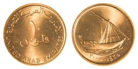 fil: 10 United Arab Emirates fils coin isolated on white background