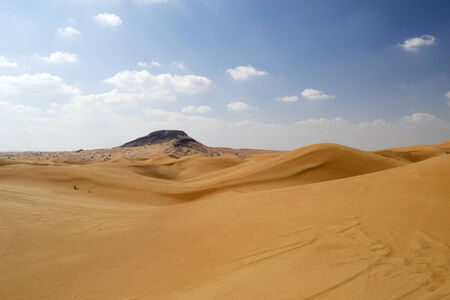 baron: Baron desert landscape with blue sky and clouds Stock Photo
