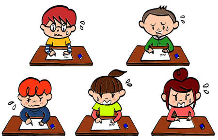 Elementary school students taking a test at their desks at school 스톡 콘텐츠