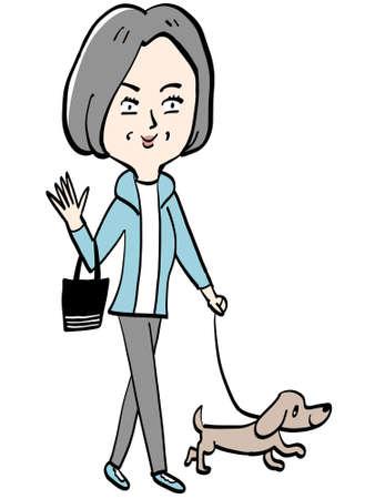 An elderly lady walking her dog.