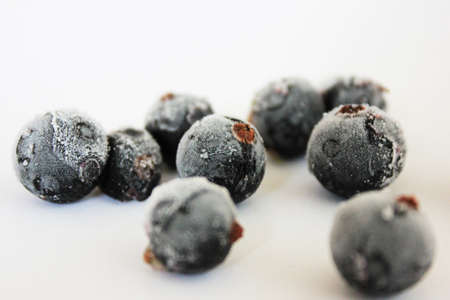 Frozen black currants photo
