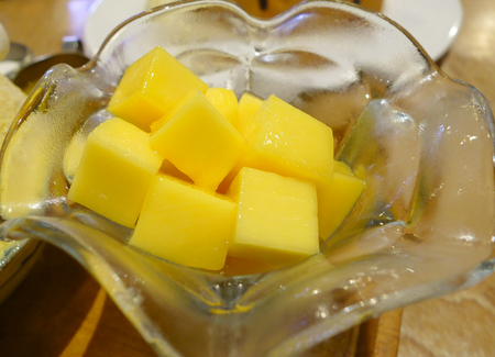 Mango Slice Cut to Cubes in the Glass. Diced Mango.