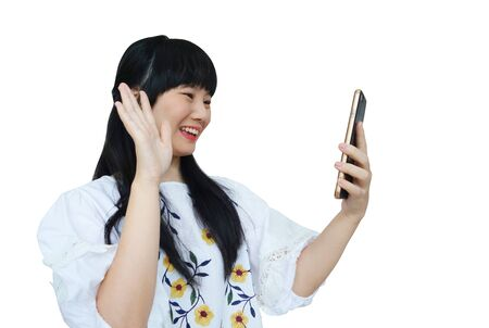 Cute Asian Girl Talking on Mobile Phone with Smile Face. isolated on White Background.