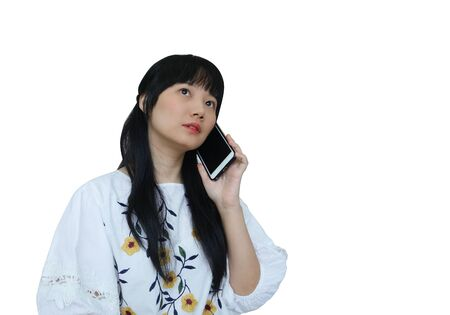 Cute Asian Girl Talking on Mobile Phone with Serious Face. isolated on White Background.