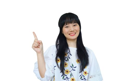 Cute Asian Girl Smiling and Pointing Finger at Side. isolated on White Background.