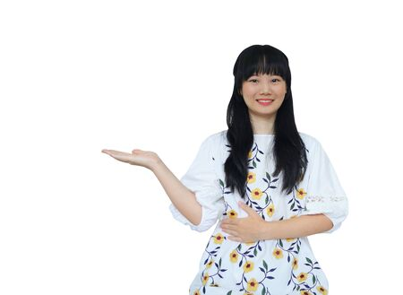 Cute Asian Girl Presenting Hand at Side. isolated on White Background. Reklamní fotografie