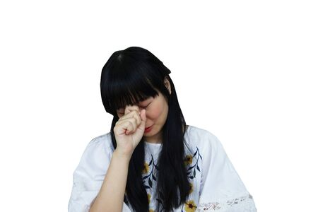 Cute Asian Girl Looking Sad from Headache. isolated on White Background.