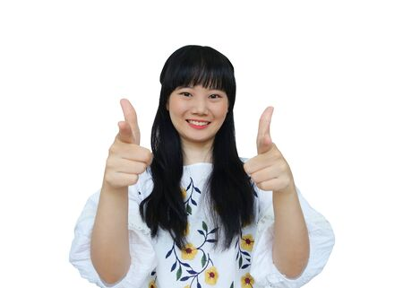 Cute Asian Girl Smiling and Pointing at Camera. isolated on White Background.