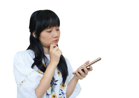Cute Asian Girl Thinking while Using Mobile Phone with Serious Face. isolated on White Background.