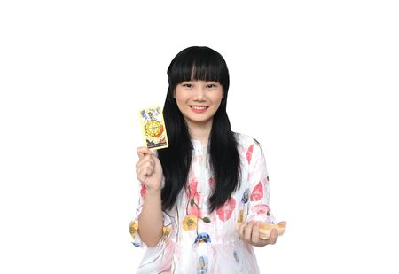 Cute Asian Girl got Wheel of Fortune Card from Tarot Deck. isolated on White Background. Reklamní fotografie
