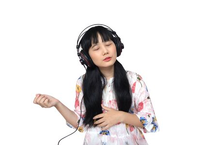 Cute Asian Girl Listenting Music though Headphone. isolated on White Background.