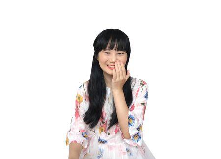 Cute Asian Girl Smiling. isolated on White Background. Reklamní fotografie