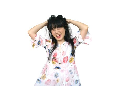 Cute Asian Girl Acting Crazy and Mess with her Hair. isolated on White Background. Reklamní fotografie