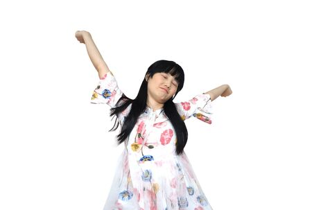 Cute Asian Girl Stretch Lazily. isolated on White Background. 免版税图像